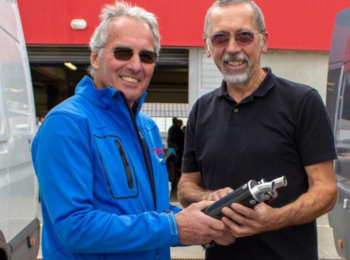 Tony Green presents Jean René Marmelat with his award at GP Originals